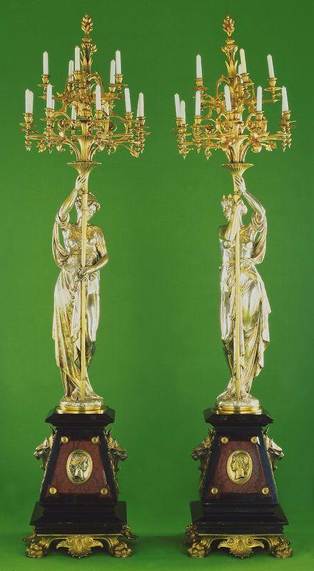 Torchère candelabra, on styrofoam base; dimensions reflect styrofoam base and candelabra; female figures, each holding a torch of many candles