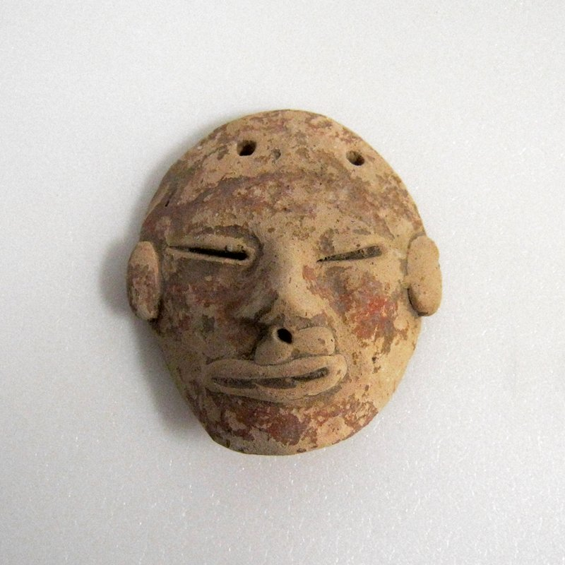 One of three miniature masks and votive heads; pottery; each measures approx. 1-2 in.