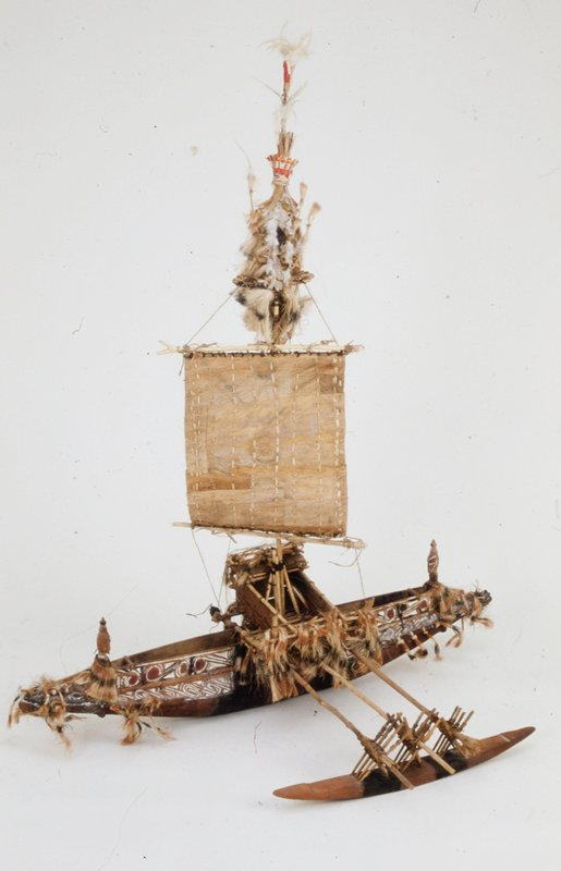 model of outrigger canoe; wood and cocoanut fibers; paddle separate from canoe- 74.79.6c