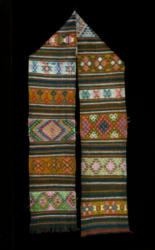 Yattha, single panel wool brocade on wool background; multicolored horizontal stripes with discontinuous supllementary patterns; fringe.