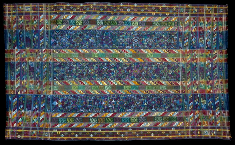 Kira, Oshem; silk/cotton brocade on blue or black cotton background; L.90 in., W.54-1/2 in. 3 panels, multicolored stripes with discontinuous supplemantary weft patterns, predominantly triangles; fringed.