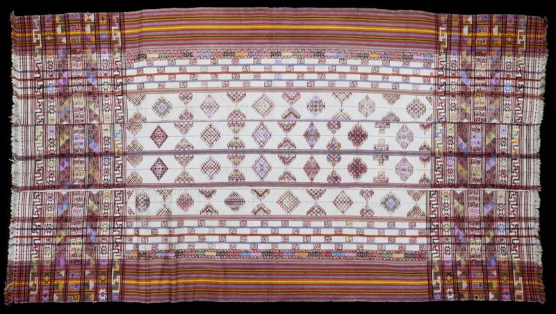 Kira, Kushotara; silk/cotton brocade on white cotton background; L.91 in., W.49-1/2 in. 3 panels, multicolored discontinuous supplementary weft design on natural ground; overall pattern at either end; red, blue, yellow, green stripes at selvedge edges; fringe.
