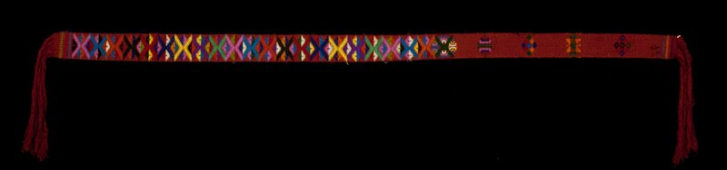 Kera, man or woman's belt piece; cotton/ silk brocade on cotton background; L.66in., W.2-1/8 in. multicolored discontinuous supplementary weft on dark red ground; fringe.