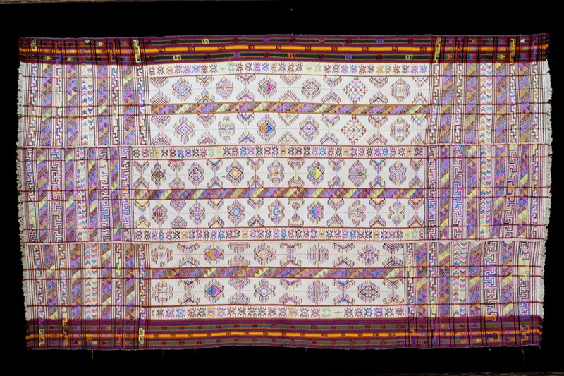 kira, Kushotara; silk/cotton brocade on white cotton background; L.102, W.58 in. 3 panels; discontinuous supplementary weft design in pinks, purples, yellows, greens on natural ground with red, blue, green, yellow stripes at borders, fringe.