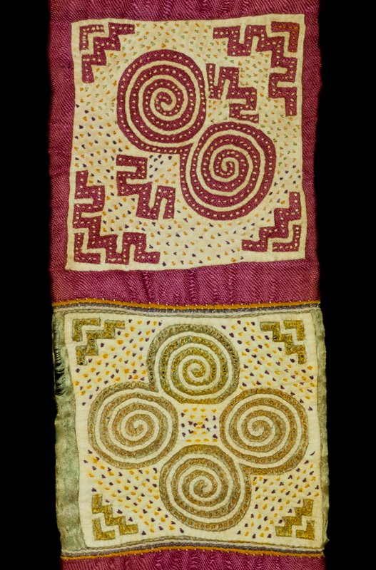 Two Belts, c.1910-20,silk, cotton, natural dyes, applique, and embroidery. Snail and cockleshell designs. Originally sewn together at one end, silk sashes attached to the other two ends. Worn wrapped twice around the waist and tied with silk sashes. Part of a ceremonial costume.
