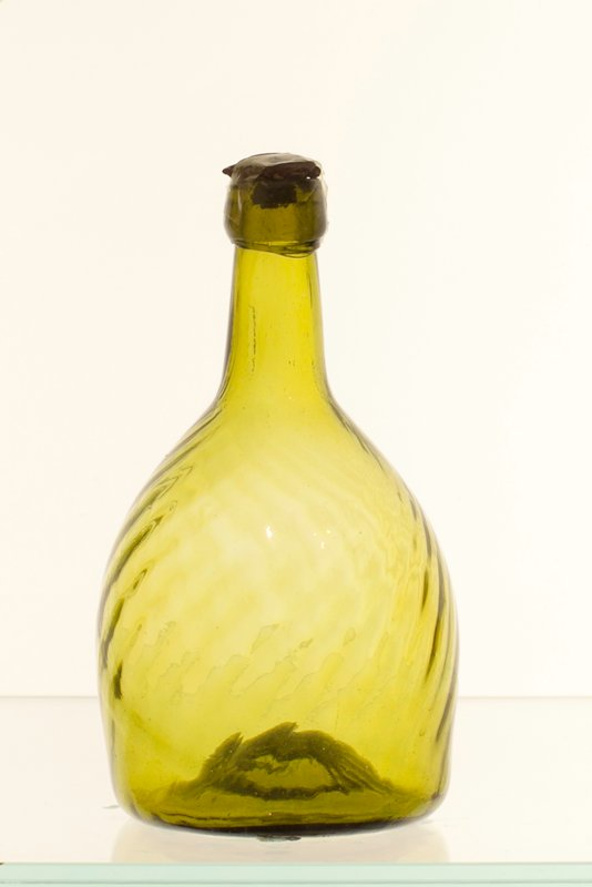 club bottle, yellow olive-green color, 24 ribs, right hand swirl and vertical ribbing; attributed to Zanesville; bottle and dishes from Ohio Manufacturers, 159 items in all, from the Walter Douglas Collection in Centerville, Ohio