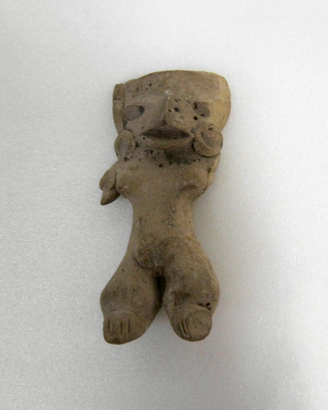 Standing Figure with stub arms, button slash feet, applique earplugs, pinch nose and arm rosette. Burnished buff clay,. Right arm missing at shoulder, Mexican (Michoacan) 200-600AD