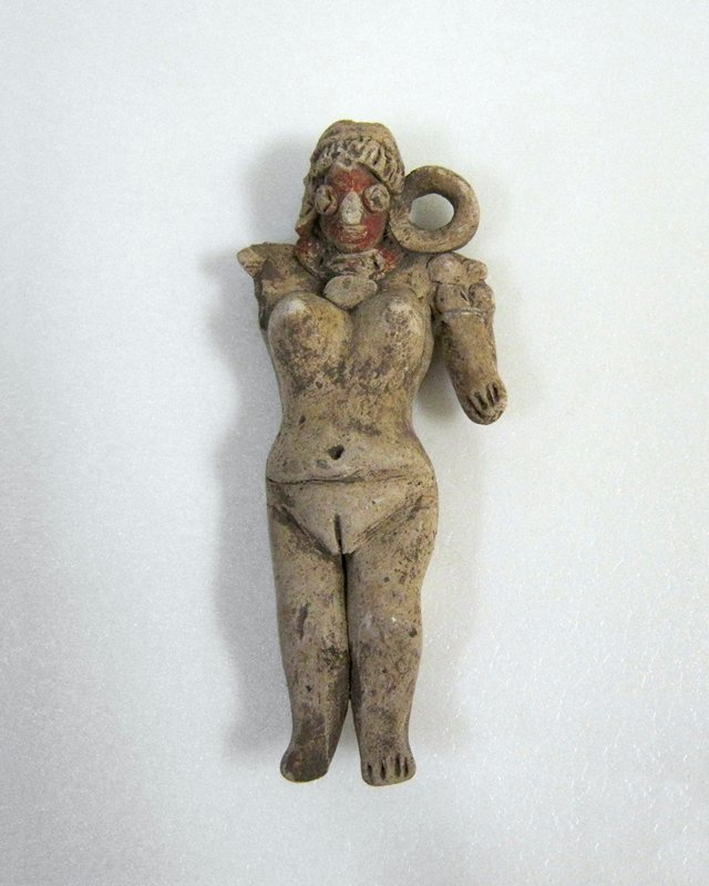 Standing Female Figure with large circular loop earspools, necklace with pendant, large breasts, incised leaf style hair, double headband and ritual scarification. Beige clay with traces of red pigment. Left arm and left hollow earspool missing, Mexican (Michoacan), 200-600AD