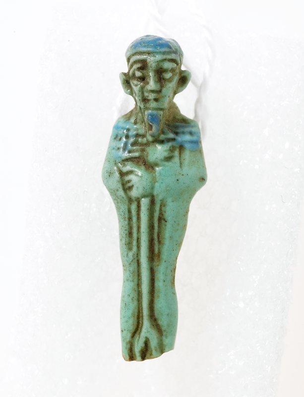 Ptah Amulet, faience, Egyptian, century? cat. card dims H. 1-3/8'; NO PHOTO ON CAT. CARDS Turquoise colored faience, pierced for suspension
