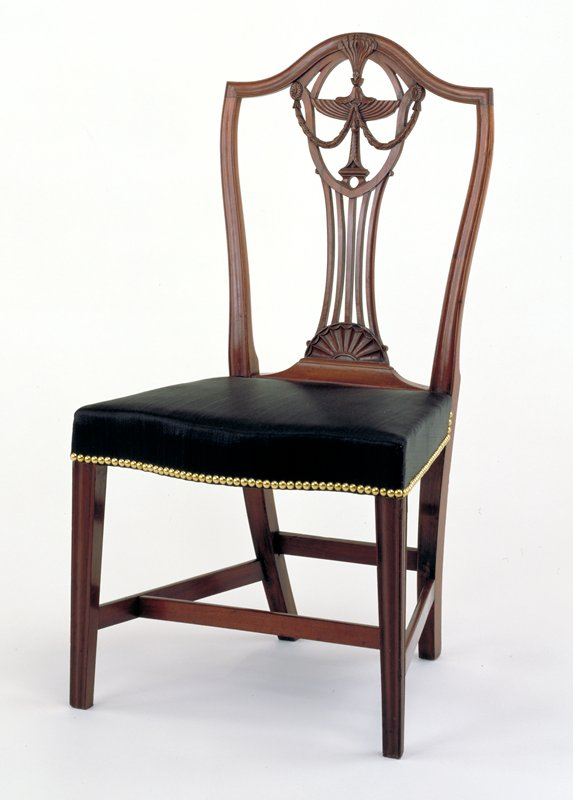 Federal Side Chair, c.1800 from Rhode Island. Mahogany with red oak and birch as secondary woods. Straight legs, splat with feather and swag motif. Pair with 84.3.1.