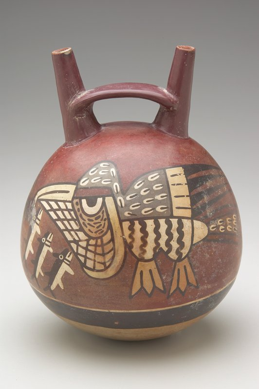 Polychrome Round Pot with double spout linked by bridge; design shows large pelican about to eat 3 small black and white killer whales on red background