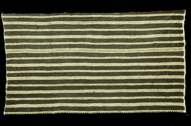 Mud Cloth skirt; Wele design: striped pattern of groups of two or three solid stripes, with one variation of two dashed stripes enclosed by two solid stripes; one lone edge is printed with a row of triangles.