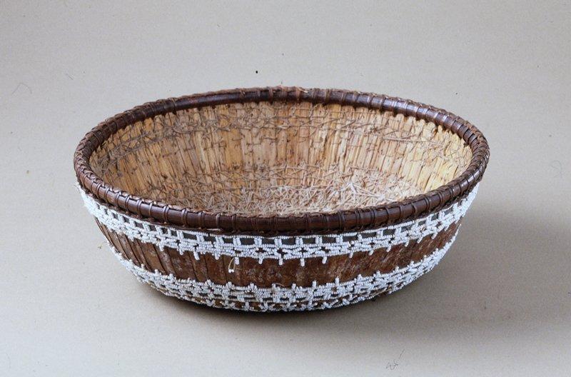 Temple Basket, fiber, stitching, beadwork, fabric covers base, small beads