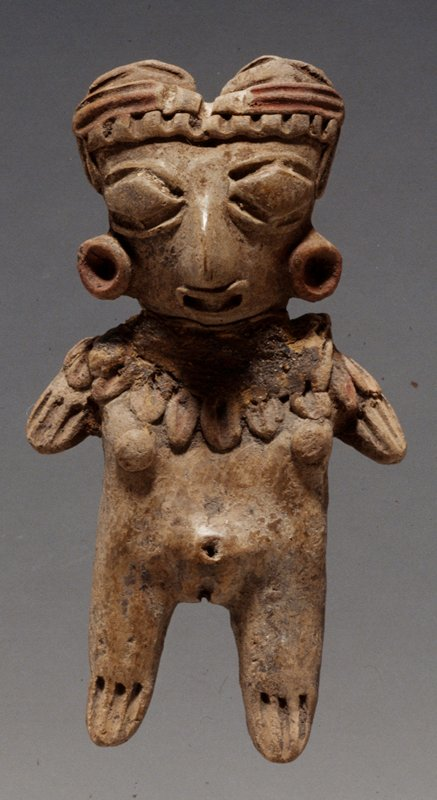 STANDING FEMALE FIGURE with diamond eyes, elaborate necklace, slash fingers and toes; center parted hair with detailed headdress, burnished buff clay; red pigment on headdress, earplugs, and necklace.