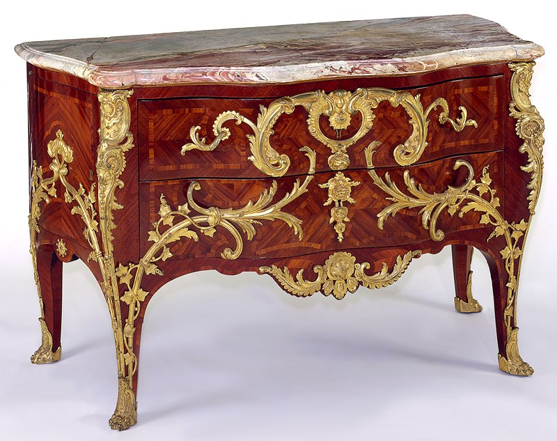 Louis XV style ormolu-mounted parquetry commode; marble top, in bois satiné with purpleheart borders; the front has two drawers with shallow cupboards at the sides, the mounts with crowned C marks