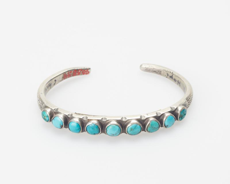 """Hammered band; set with 9 small round turquoises; stamped """"snakeskin"""" decoration cat. 161, J#74"""
