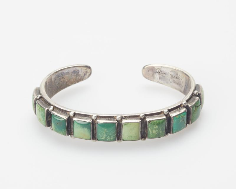 Annealed band; set with ten square turquoises; teardrop and stamped decoration cat. 87, J#121