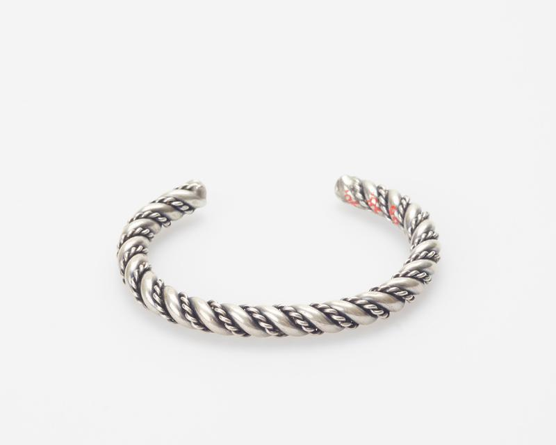 Hopi; pair of identical gaurds; heavy double twisted wire overlaid with fine double twisted silver wire; cat.171(both), J#219