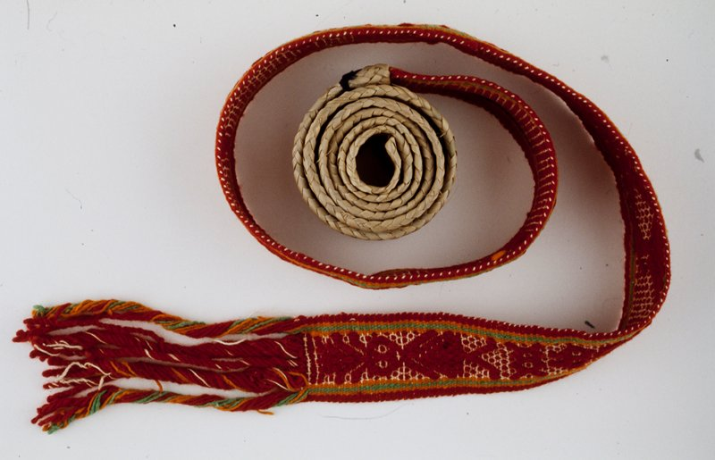 red, orange, green and white plain-weave based float weave pattern; with palm leaf end