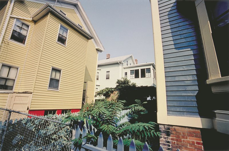 yellow House and blue House with green foliage, Providence