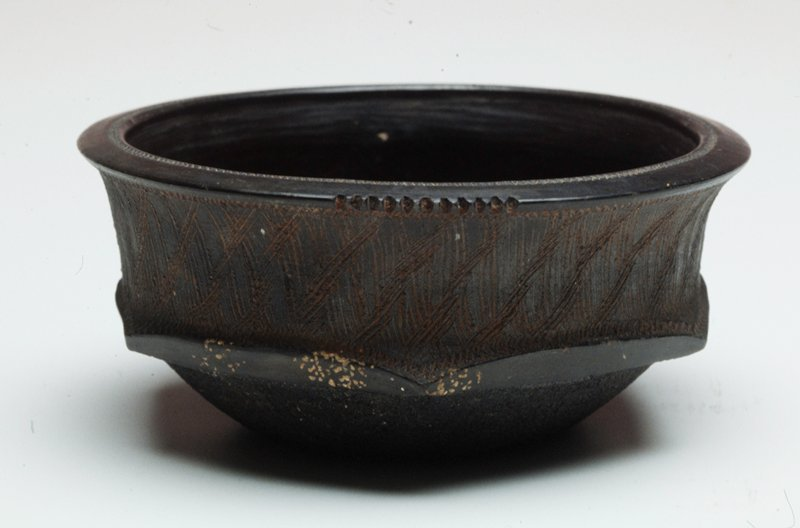 Black ceramic bowl, round with hexagon shape around the body of bowl.