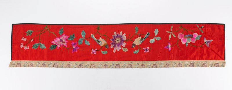 satin ground with auspicious flowers in silk embroidery, attached cotton band