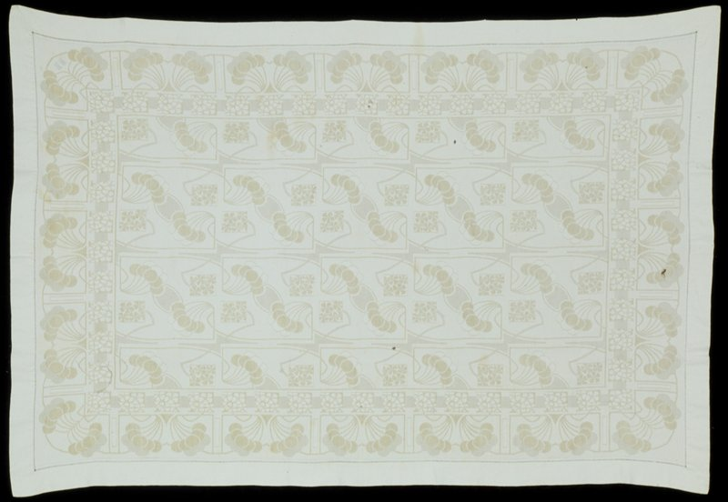 woven stylized floral design, composed of fruit and blossoms, in pale green and white ground, with embroidered initials 'MK' in corner