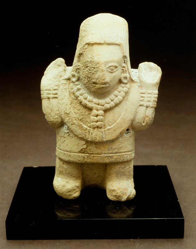 standing female figure, mold made, arms held up at sides, buff colored earrthenware; stand for this object in E1.9