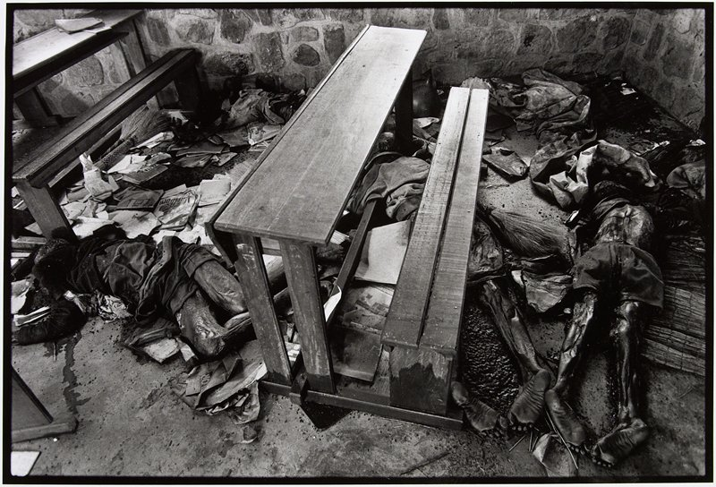 bodies laying under desks (or church pews) with books and magazines scattered throughout