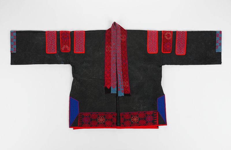 black coat with red embroidered bands on collar and near hem; also three embroidered bands on each shoulder; blue and red embroidered bands on cuffs