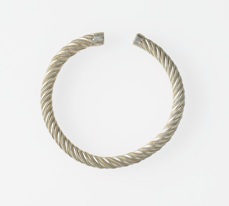 open ended bracelet with a spiral design alternating with plain and ribbed bands