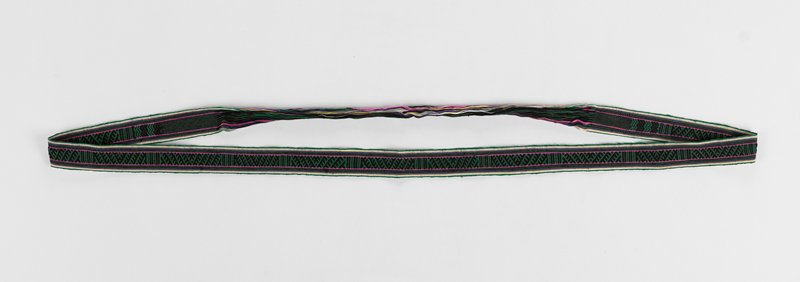 continuous weft, 17 inches of which is only horizontal strings; main central band of green and black in a feather design broken every three inches by vertical lines; accents of white, yellow, pink and purple