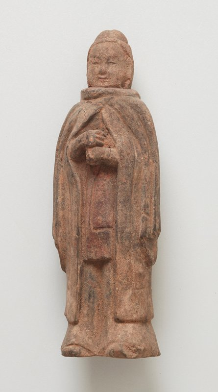 Figure of a tomb attendant in a draped cape, polychromed pottery