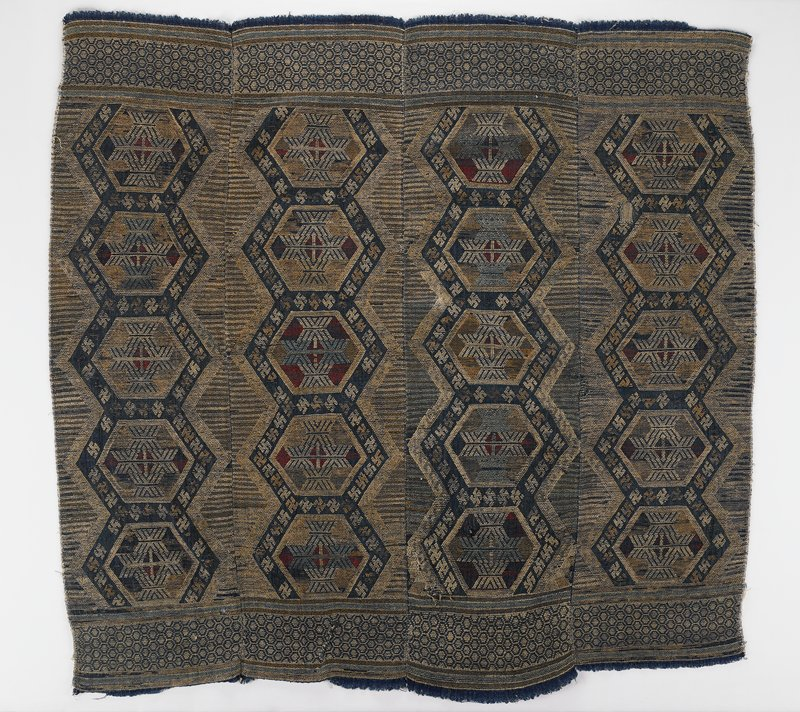 4 panels sewn together; tortoise shell design banding at two sides; each panel contains five joined large torotise shell designs with swastika patterning at edges of designs