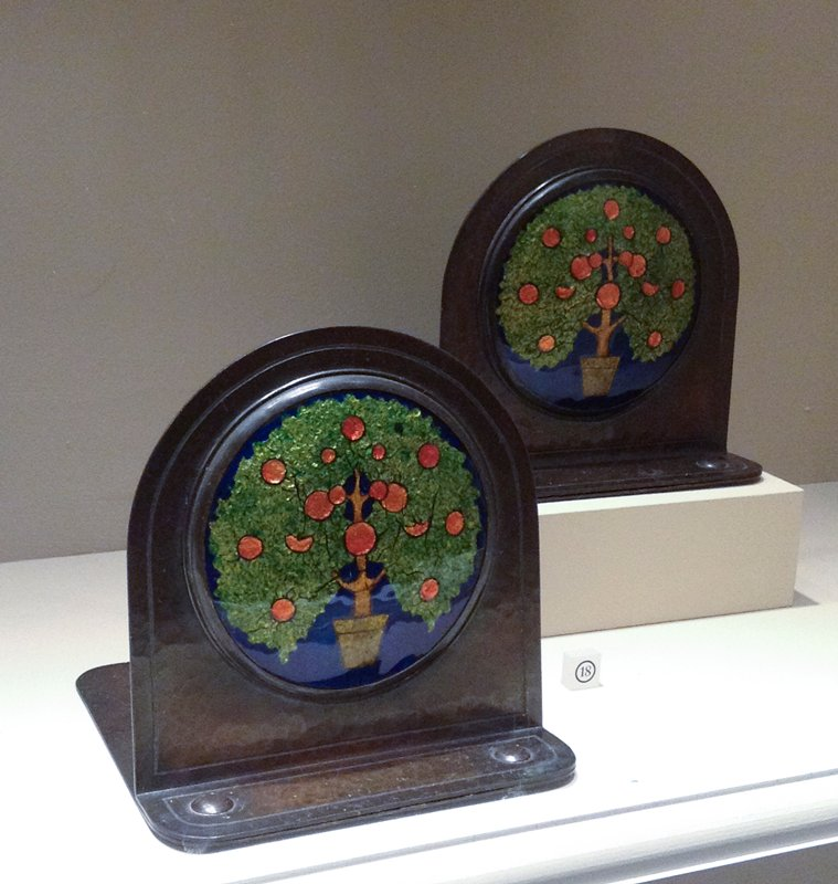 hammered copper with round enamelled plaques of potted orange trees with cobalt blue background