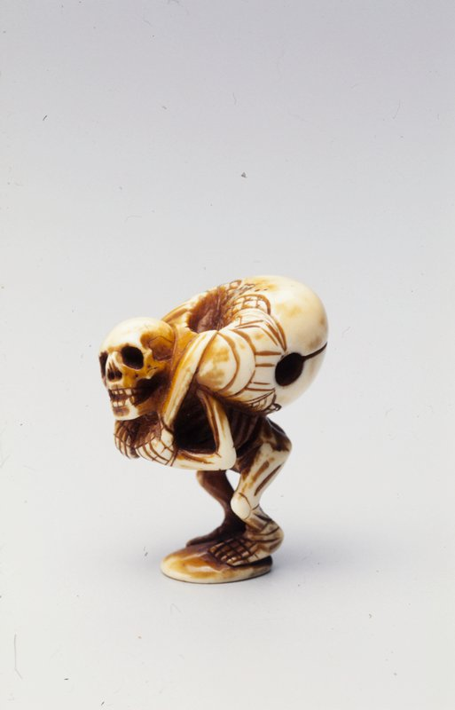 skeleton bending under the weight of a Mokugyo slung around its neck