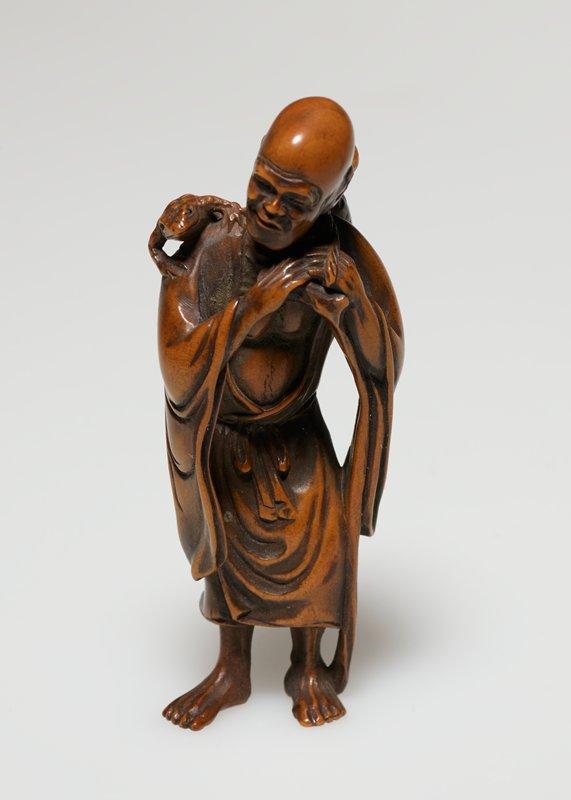 bald standing man with toad on proper right shoulder and jar shaped basket slung over proper left shoulder