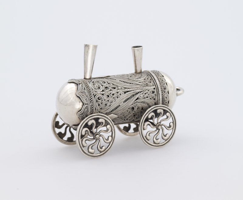 cast and filigree silver box in the shape of round train car with lid