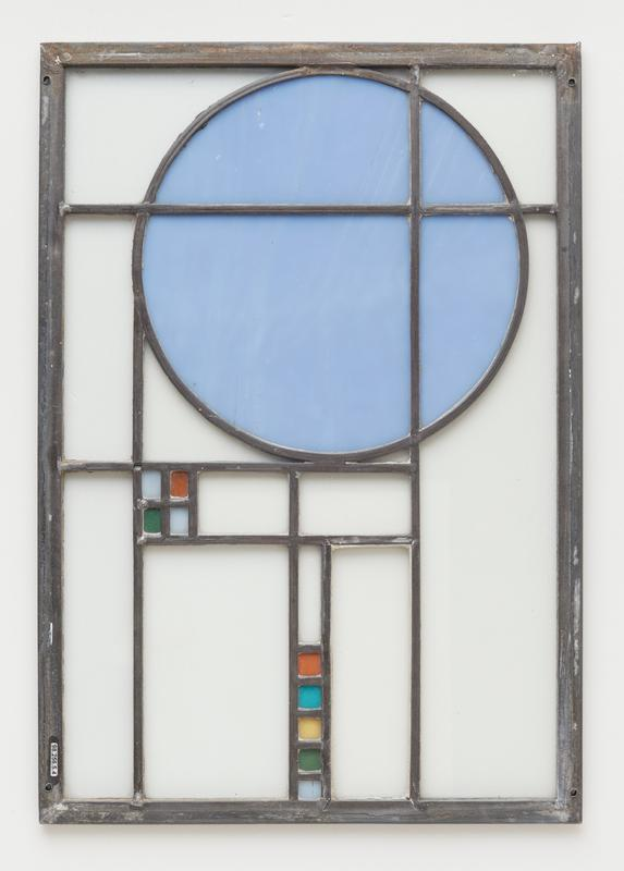 clear glass panels with blue circle; square made up of 4 small rectangles (light blue, orange and green); row of small rectangles (orange, turquoise, yellow, green and light blue)