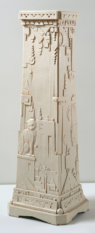 faux-Egyptian cityscape with geometric motifs; stylized cat and owl