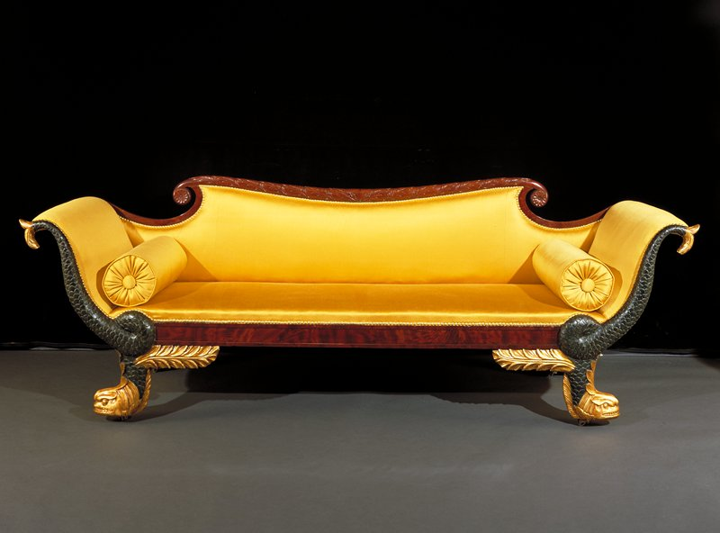 mahogany, verd-antique and gilt with secondary woods of maple, ash, and yellow pine; dolphins carved on facing sections of arms and dolphin's heads form the feet; Crest rail curved, adorned with carved oak leaves and ends at each end with carved rosettes. a=sofa; b&c=cushions