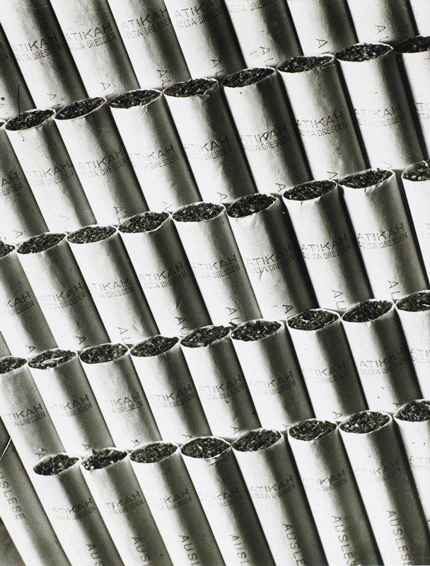 5 rows of cigarettes; 'Atikah/Delta Dresden' on tip of each cigarette