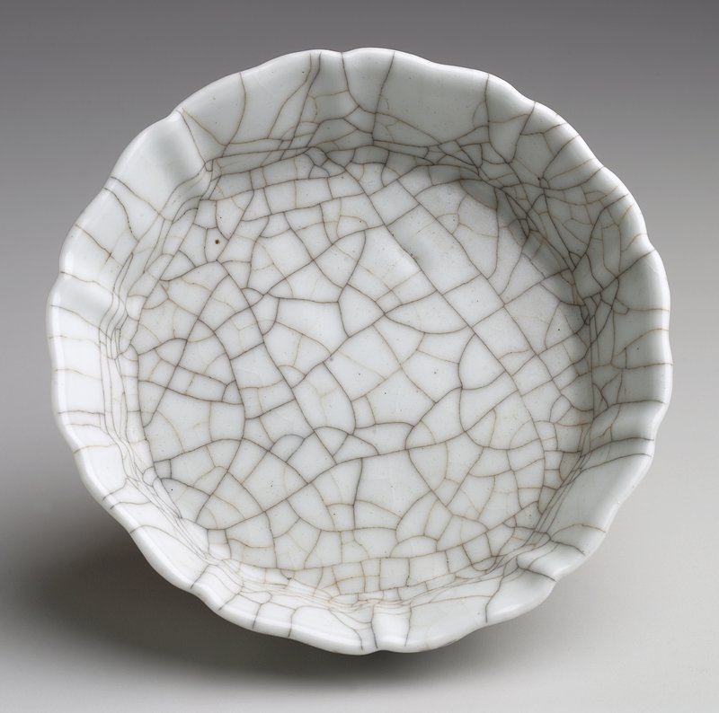 Small dish with fluted edge; grey glaze with darkened crackle