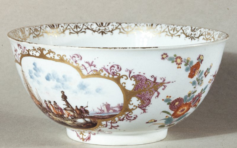 Bowl, ceramic, cat. card dims H 3-1/8 x diam 6-5/8' Two panel scene of ships landing in cloosed in border of gold with lavender sprays of flowers between; shipping scene in purple in bottom.