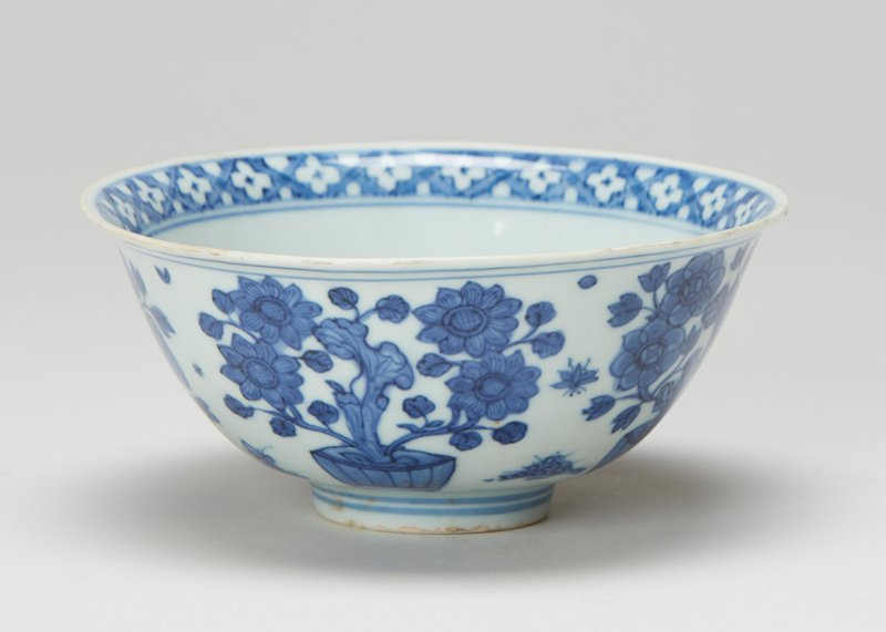 Wan-li mark (1573-1619), but K'ang-hsi period (1662-1722) One of a pair of bowls (83.113.5-6); porcelain, underglaze blue decoration of flowers in pots on outside, geometric bands near top of inside, four character Wan-li marks.