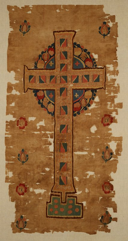 Latin Cross placed in front of wreath. Secondary design of alternating rosettes and leaf forms along vertical edges. Woven in Egypt about 5-6th century for church use, possibly as a sanctuary curtain. Plain weave with tapestry patterning. Pall with a Latin Cross. Woven fabric