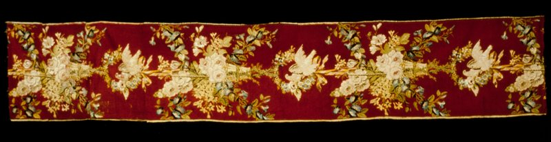 Panel, silk brocade. Red ground with design of flower baskets hung from ribbons, trailing morning glory vines, alternating with floral wreaths enclosing pairs of doves. Designed for Catherine II, Empress of Russia. Formerly at Tsarkoe Selo near St. Petersburg, removed before 1917. Other panels in collections of Musee des Arts Decoratifs, Paris, and Musee Historique des Tissus, Lyons.