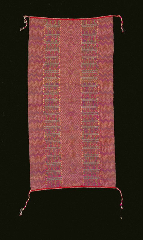 5 horizontal bands with multicolored woven geometric designs; alternating black and pink stripes on back; twisted white, pink and black threads form tassels with beaded ends at corners for tying