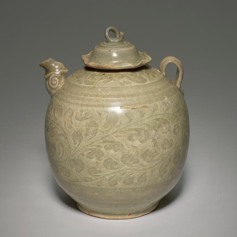 rounded body on short, wide foot; short, organic spout; small handle; incised light foliate bands around body and mouth; inward-curling lid edge with looped handle