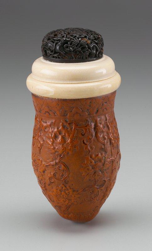 gourd decorated with flowers and organic patterns; cover with tortoise shell carved with a figure at center, surrounded by a bat, a deer and a bird